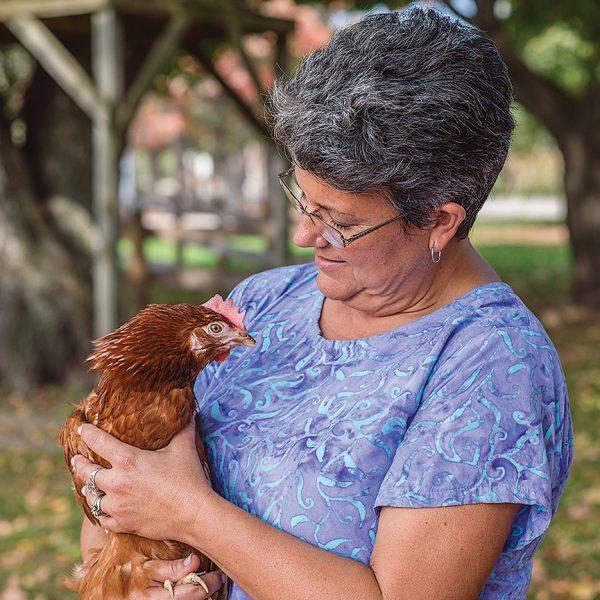 Egg Farmer with Hen - Five Acre Farms